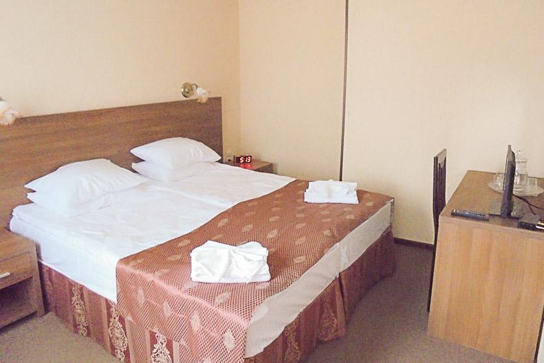 Фотография спальной комнаты номера Люкс